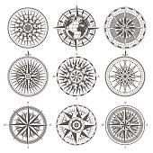 Set of vintage antique wind rose nautical compass signs labels emblems elements