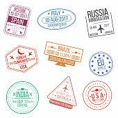 Set of visa passport stamps. International arrivals sign rubber stamps