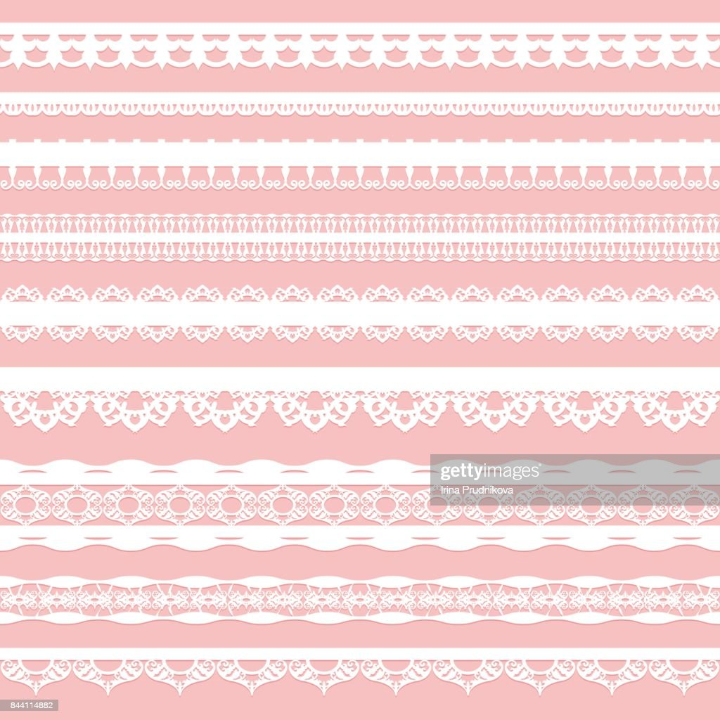 Set of white lace braid isolated on a pink background.
