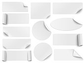 Set of white paper stickers of different shapes with curled corners isolated on white background. Round, oval, square, rectangular shapes. Vector illustration.