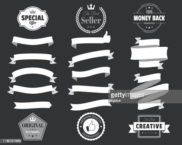 set of white ribbons, banners, badges, labels - design elements on black background - medal stock illustrations
