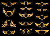 Set of wings icons in golden style. Design elements for label, emblem, sign.