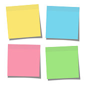 Set of yellow, green, blue and pink paper sticky notes glued to the surface isolated on white