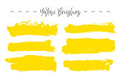Set of yellow ink brush strokes.