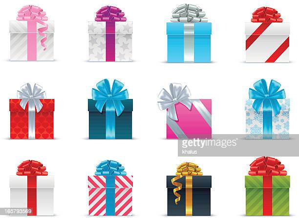 several brightly wrapped gift boxes with ribbon - gift stock illustrations