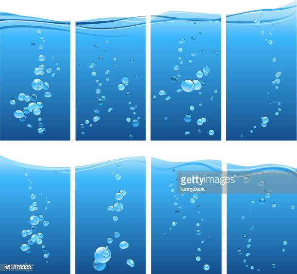 Several sets of underwater bubbles