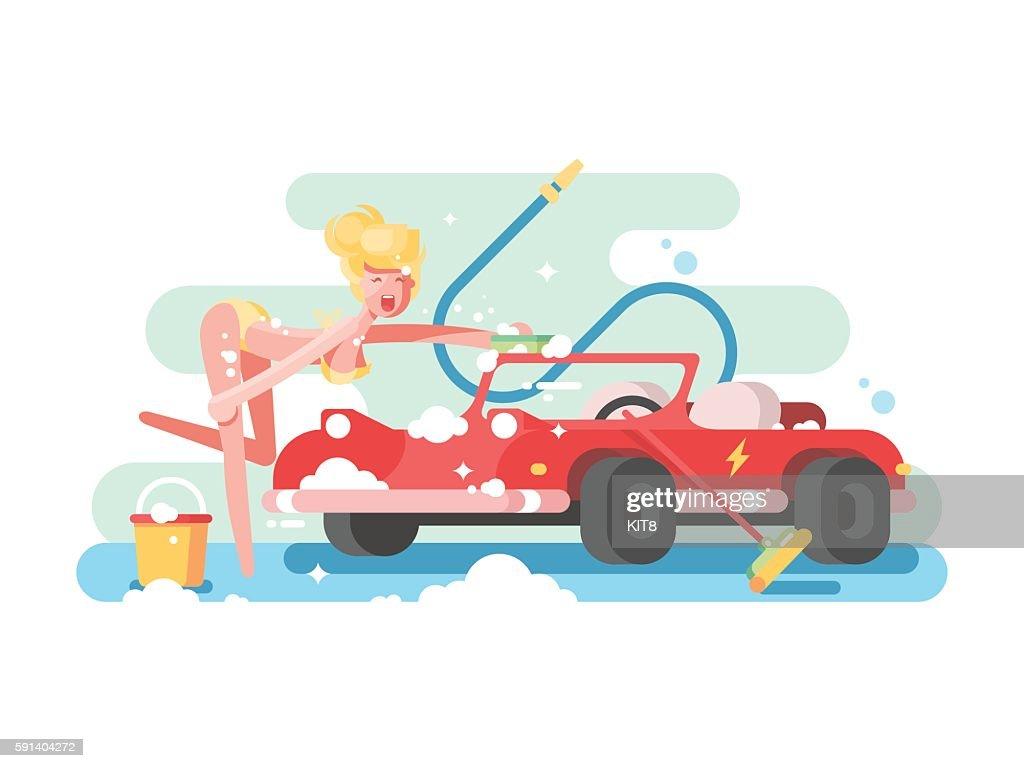 Sexy girl washing a car