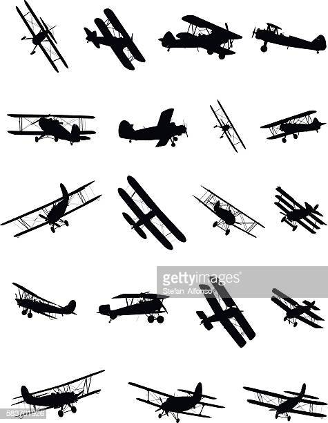 shapes of biplanes - air travel stock illustrations, clip art, cartoons, & icons