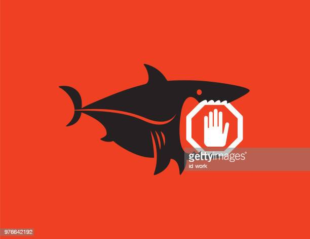 shark holding stop sign