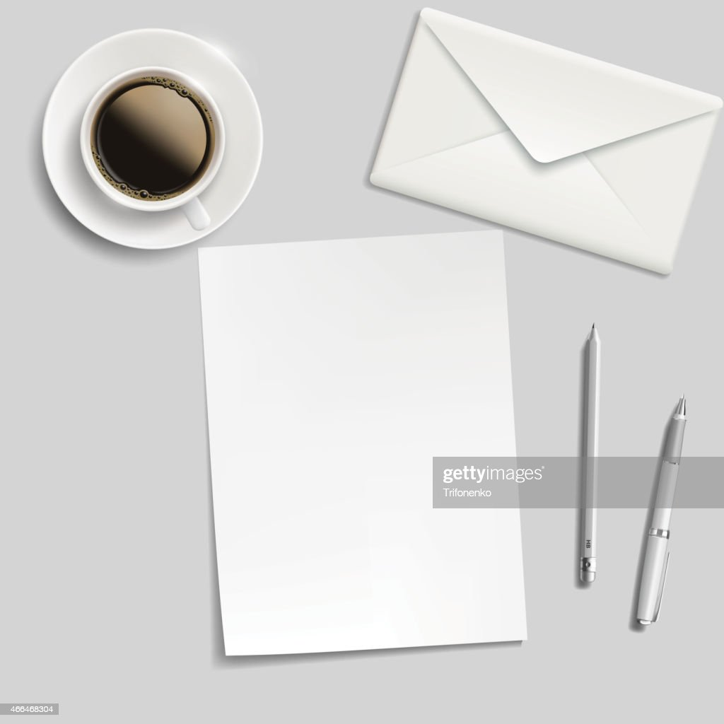 sheet of paper, envelope, pen and cup of coffee