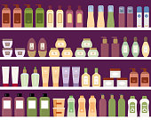 Shelves with colorful cosmetic products in plastic bottles.