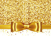 Shiny gold satin ribbon on white background