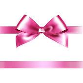 Shiny pink satin ribbon on white background