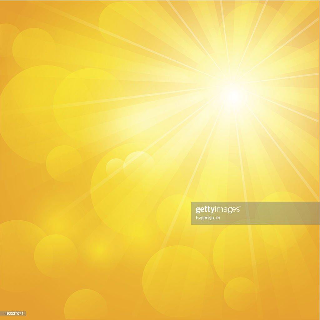 Shiny sun on orange background