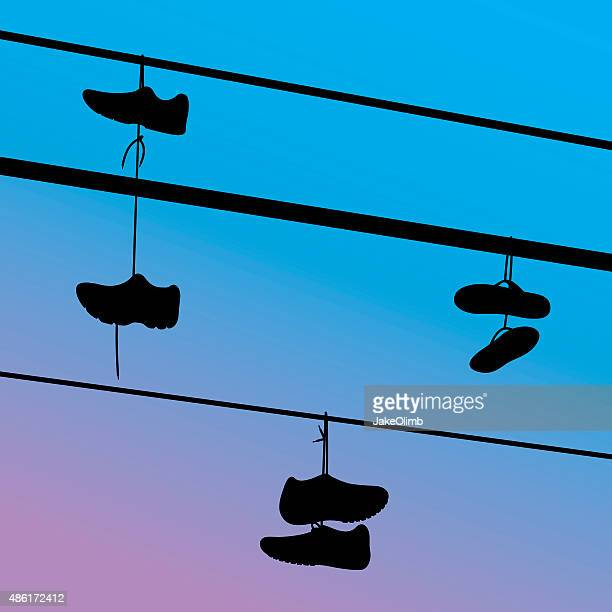 shoes hanging on telephone wire silhouettes - steel cable stock illustrations