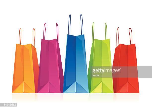 illustrations, cliparts, dessins animés et icônes de sacs de shopping dans une rangée sur blanc-illustration - sac