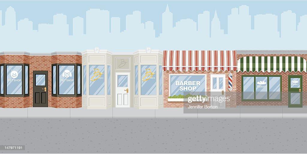 Shops along a city street : Vector Art