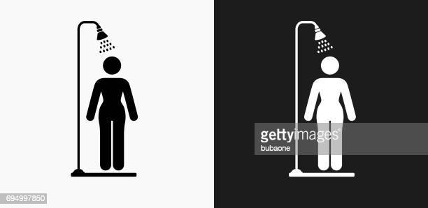 showering icon on black and white vector backgrounds - shower stock illustrations, clip art, cartoons, & icons