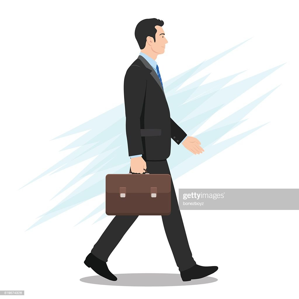 Side View of a Businessman Walking Forward