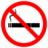 NO SMOKING sign. Cigarette icon with filter and smoke in crossed out red circle. Vector
