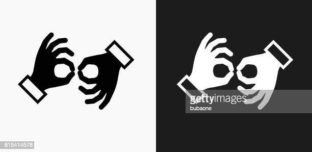 sign language icon on black and white vector backgrounds - sign language stock illustrations, clip art, cartoons, & icons