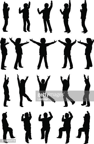 silhouette children [enjoying and cheering boys](winter version) - side view stock illustrations, clip art, cartoons, & icons