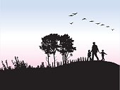 Silhouette O Father And His Kids Outdoors