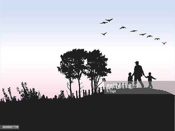 silhouette o father and his kids outdoors - hill stock illustrations, clip art, cartoons, & icons