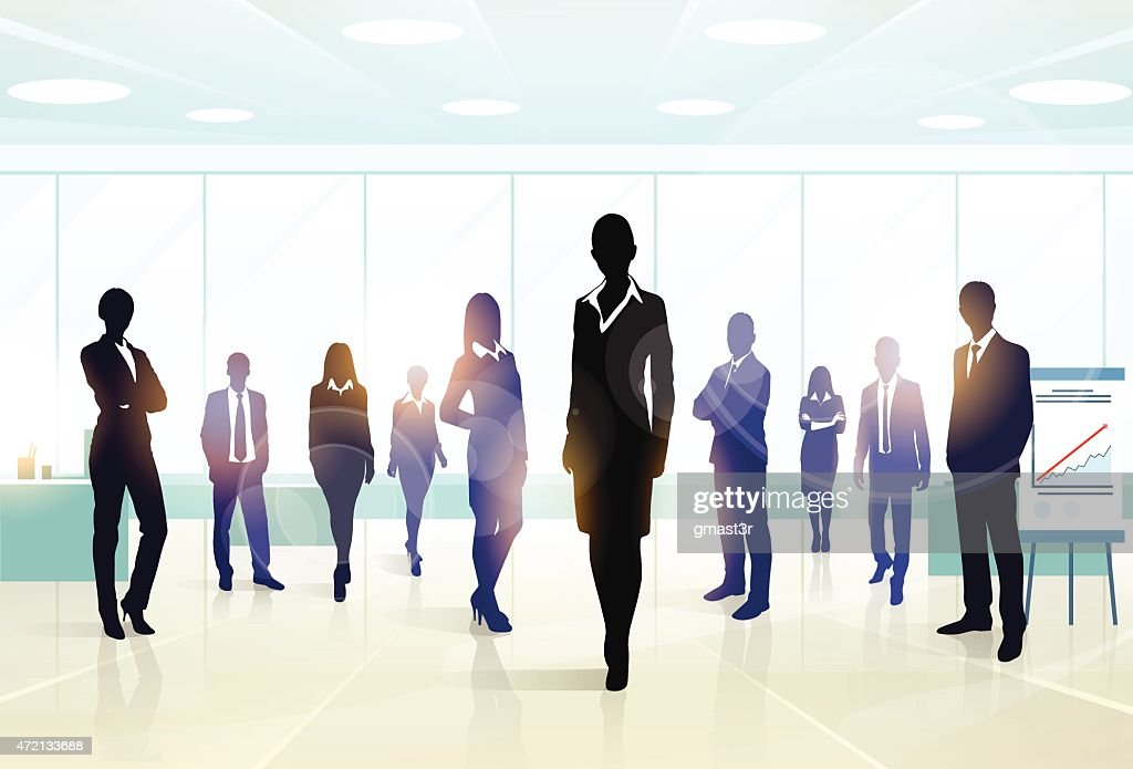 A silhouette of a business executive team