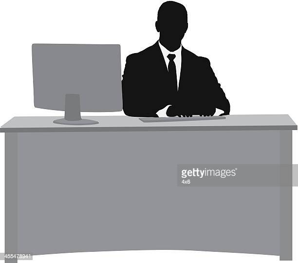 Silhouette of a businessman at his desk