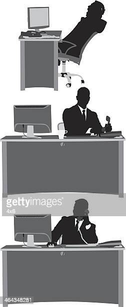 Silhouette of a businessman at work
