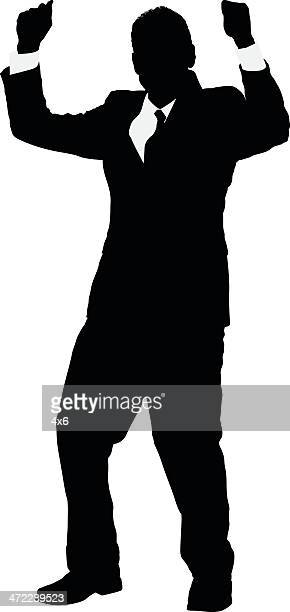 Silhouette of a businessman celebrating his success