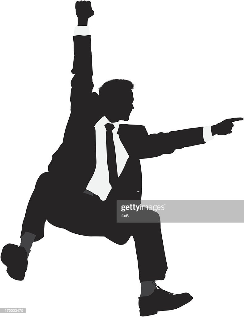 Silhouette of a businessman hanging and pointing