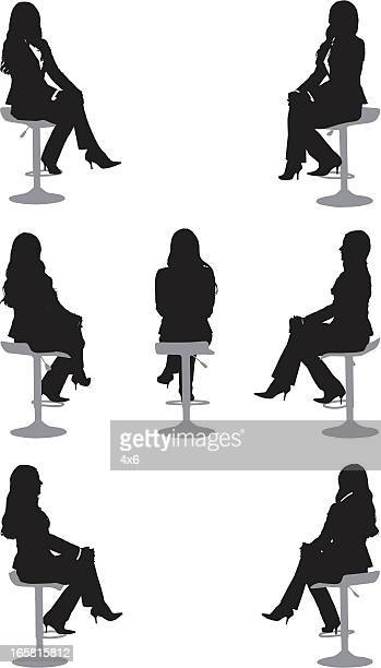 Silhouette of a businesswoman sitting on chair