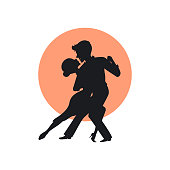 silhouette of a couple dancing tango