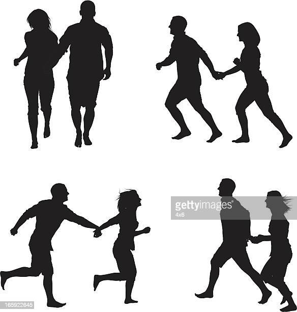 Silhouette of a couple running