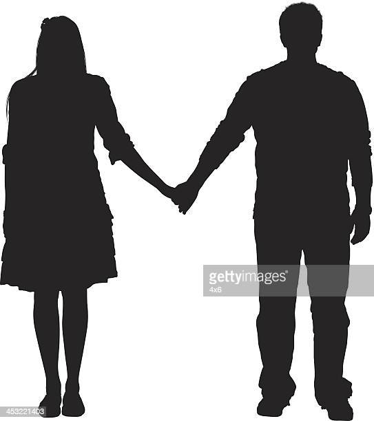 Silhouette of a couple standing