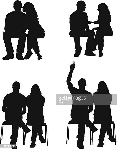 silhouette of a couple - sitting stock illustrations