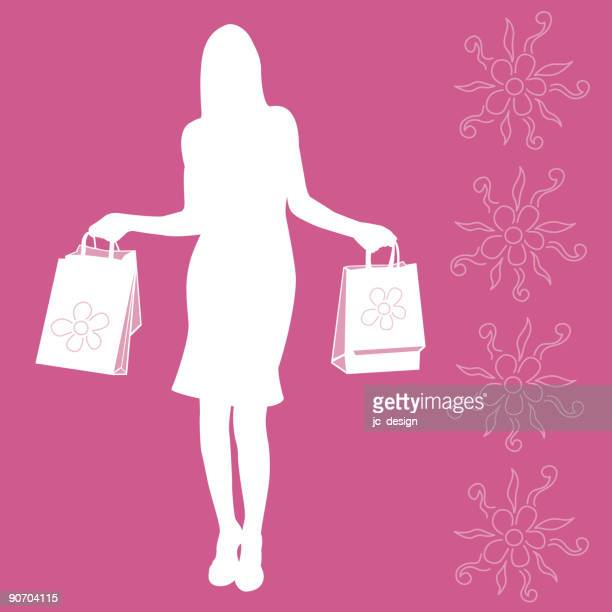 A silhouette of a female shopper holding bags