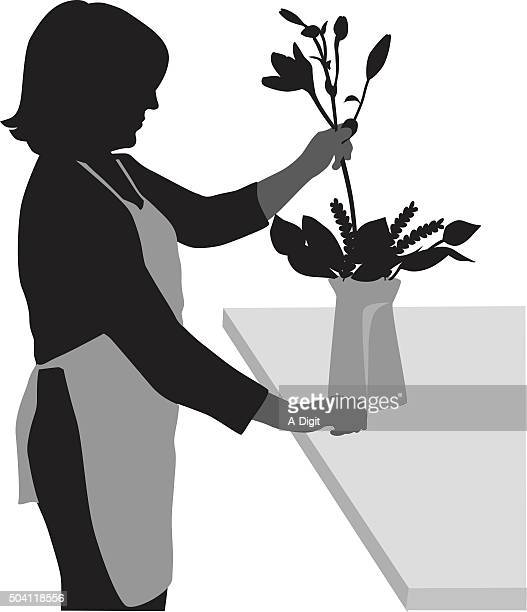 Silhouette Of A Florist At Work