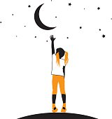 Silhouette of a girl reaching for the stars