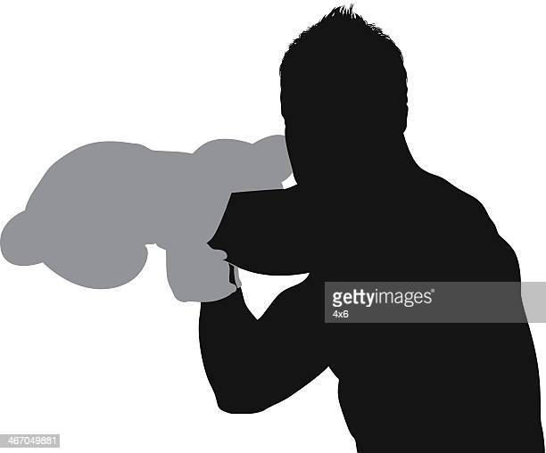 silhouette of a male boxer in action - fighting stance stock illustrations, clip art, cartoons, & icons