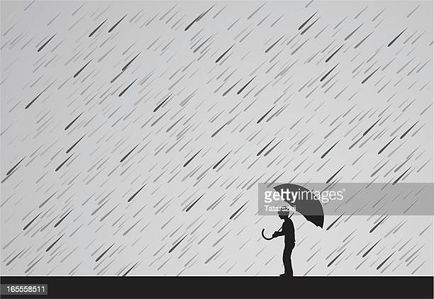 a silhouette of a man holding an umbrella in the rain - monsoon stock illustrations, clip art, cartoons, & icons