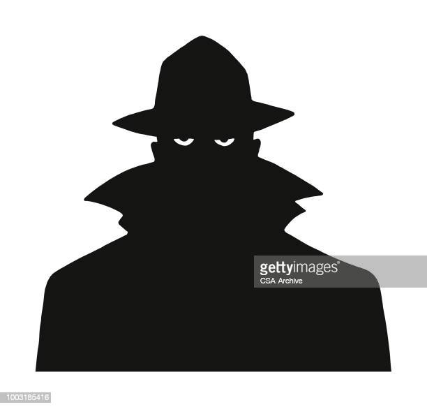 silhouette of a man in a trench coat and hat - criminal stock illustrations