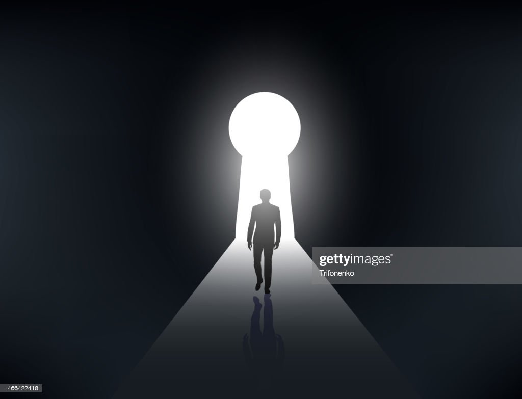 silhouette of a man walking in the light