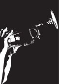 Silhouette of a person playing a jazz trumpet