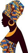 Silhouette of African girls in bright colored turban