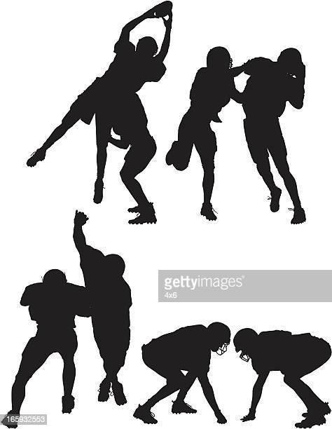 Silhueta de jogadores de futebol americano em ação