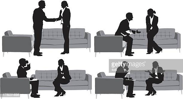 Silhouette of business couple having discussion