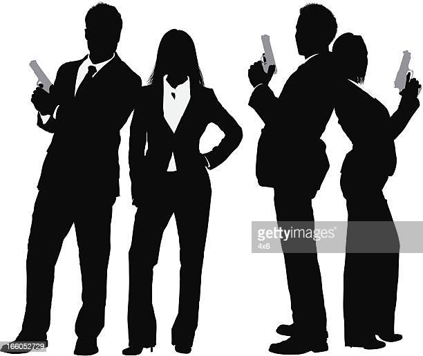 Silhouette of business couple with a gun